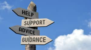 Signs showing directions for help, support, advice and guidance